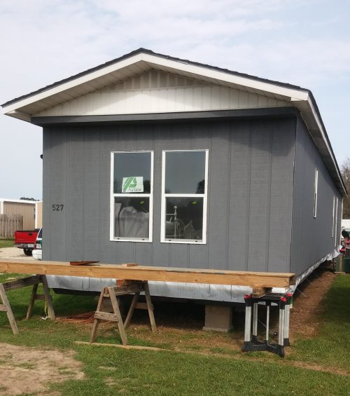 A look at guy 39 s 21 000 diy single wide transformation mobile home living for How to paint a mobile home exterior