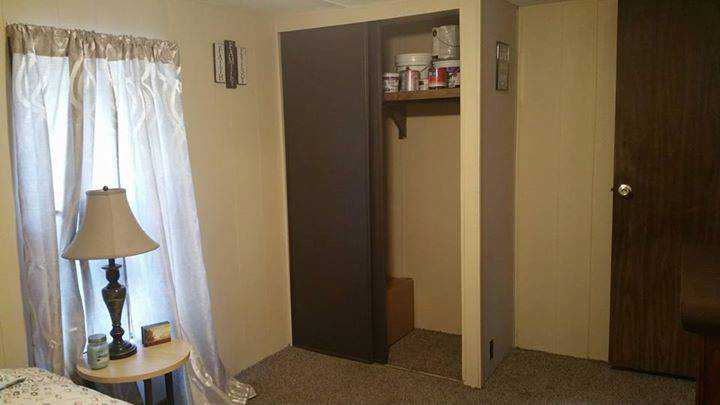 1985 Conner single wide mobile home - painted panelling and closet in bedroom - should you buy an older mobile home and remodel it - questions about removing walls in a mobile home