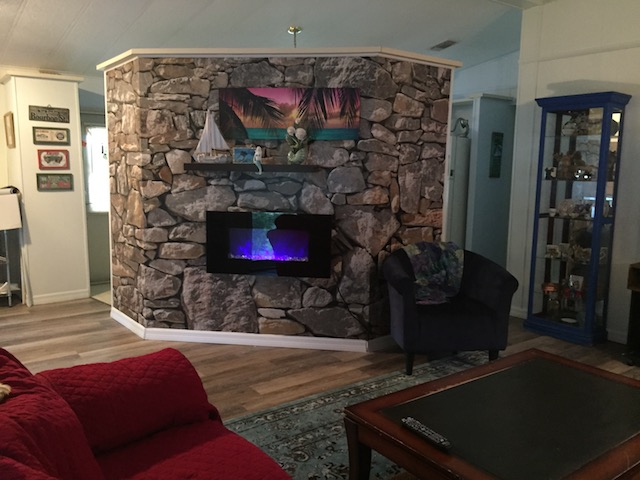 1986 Palm Harbor Single Wide Makeover - stone wall mural and faux fireplace completed