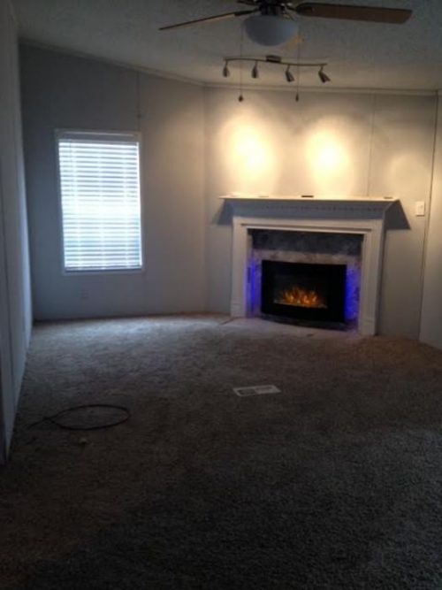 1986 double wide makeover - updated fireplace, flooring and paint in living room