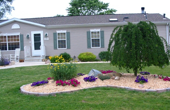 Landscaping Ideas for Mobile Homes | Mobile Home Living on economical backyard ideas, simple backyard ideas, eco friendly backyard ideas, easy low maintenance landscaping ideas, safe backyard ideas, affordable backyard ideas, no mow backyard design, low maintenance front yard landscaping ideas, dog-friendly backyard landscaping ideas,