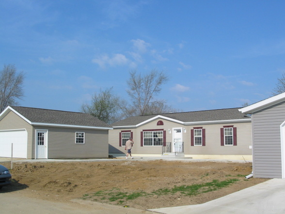 landscaping in a mobile home community - before