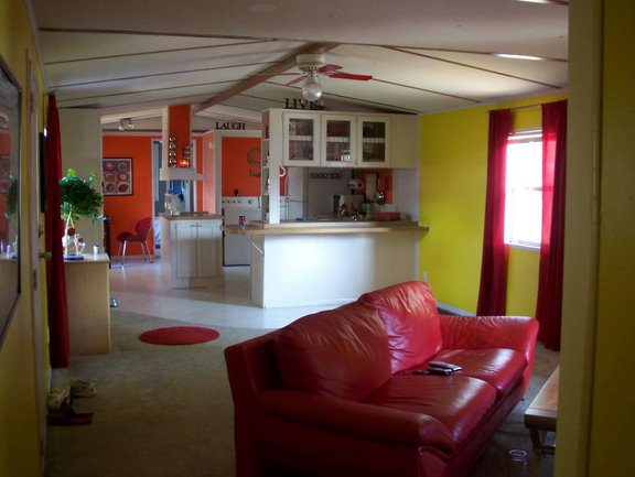 Colorful single wide makeovers part 2 mobile home living for Decorating ideas for mobile home living rooms