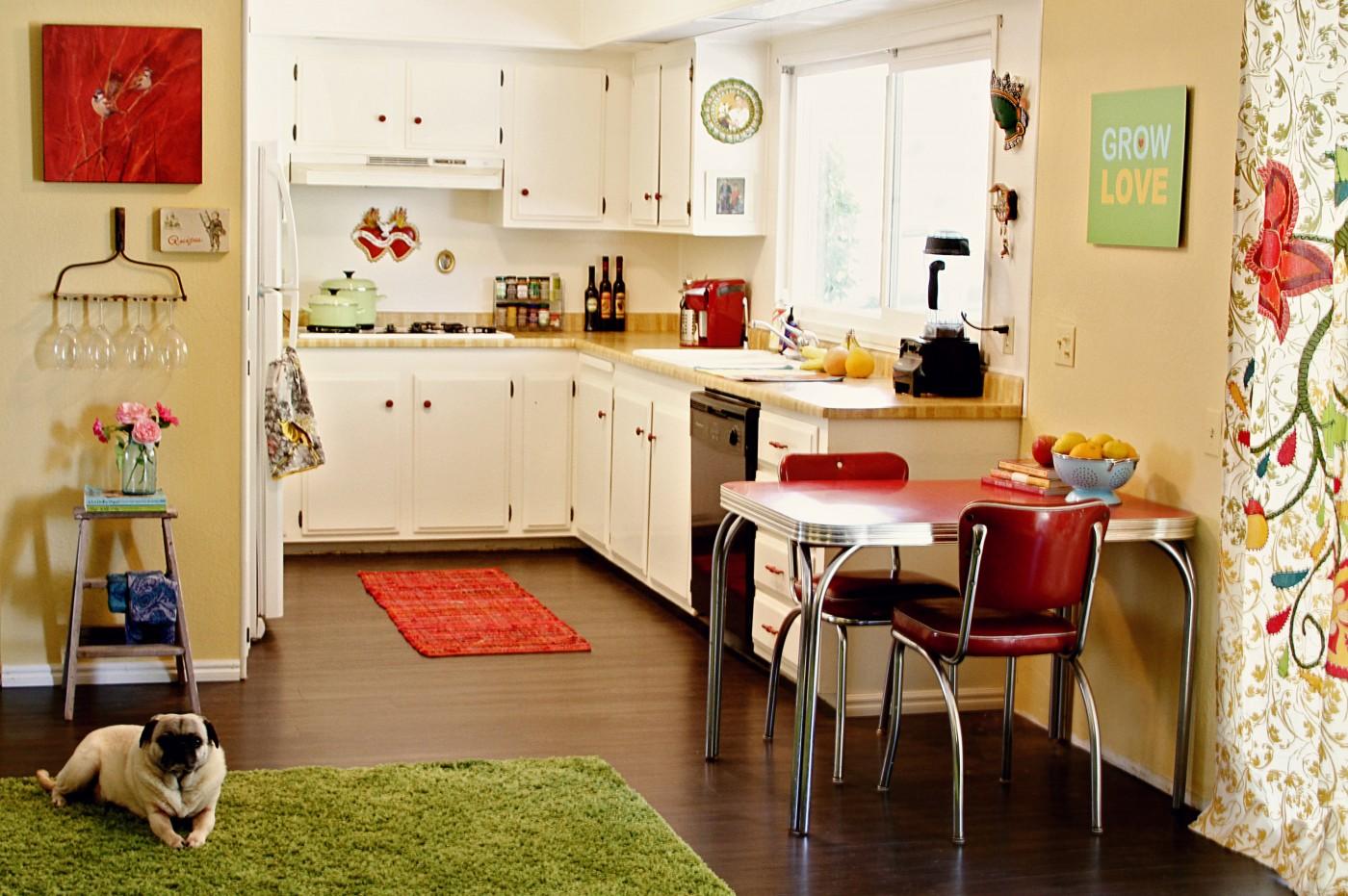 mobile home rental-orange accent rug in kitchen