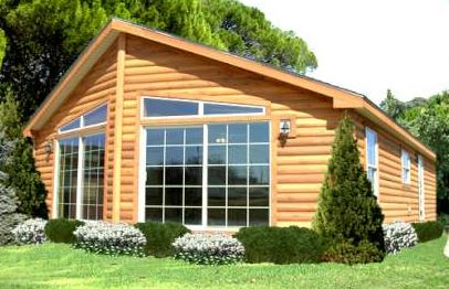 Wood sided manufactured home with picture window on end