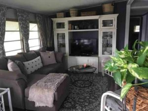 1964 Chateau - use curtains and dark paint to give small Mobile Home Living room warmth and style