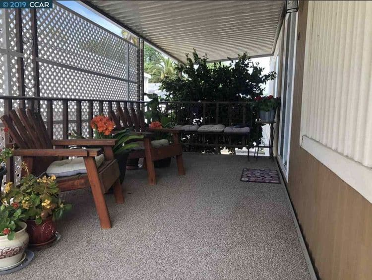 1975 Double Wide Mobile Home with shaded porch
