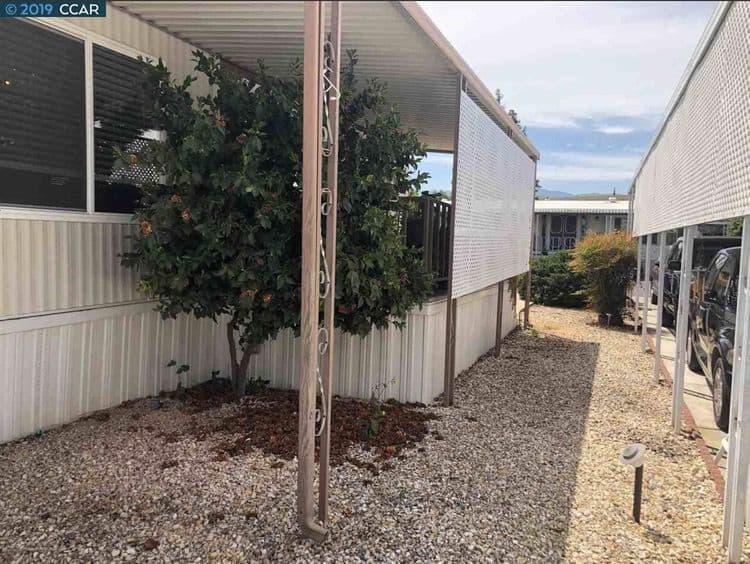 1975 Double Wide Mobile Home with shaded porch 2