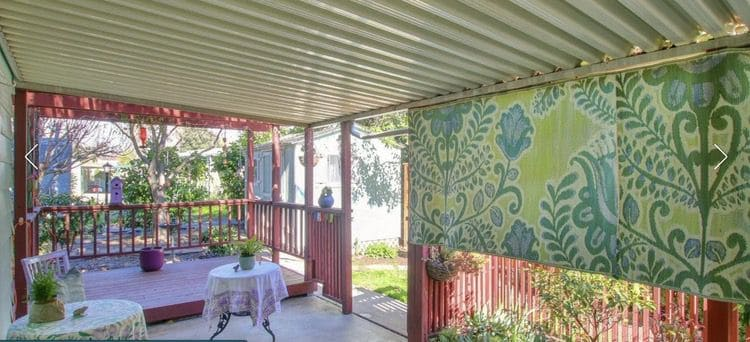 small wooden porch added behind carport