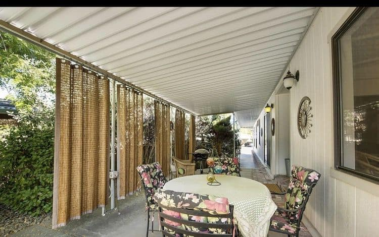 Wicker shades on carport side