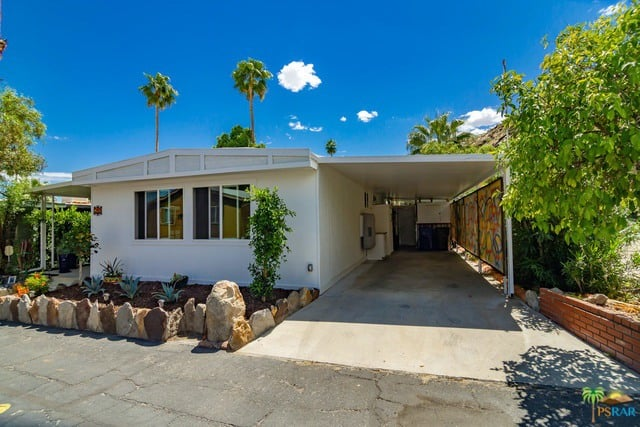 Palm Springs mobile home with awning/carport