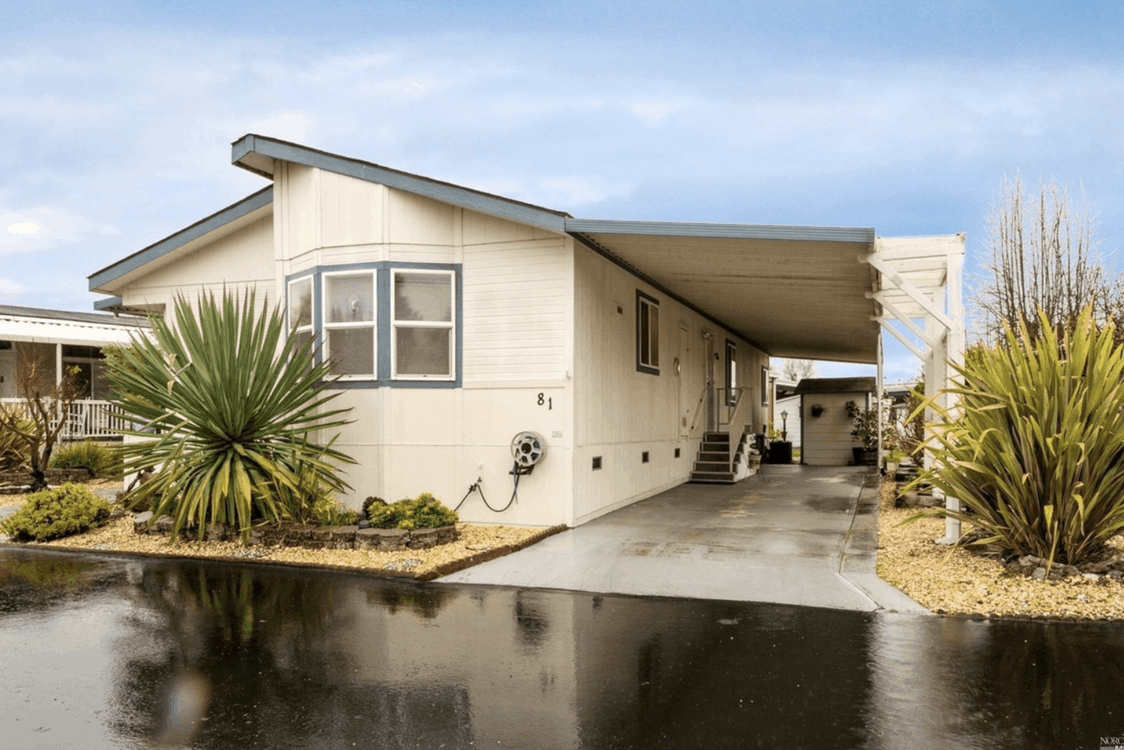 new manufactured home with covered carport