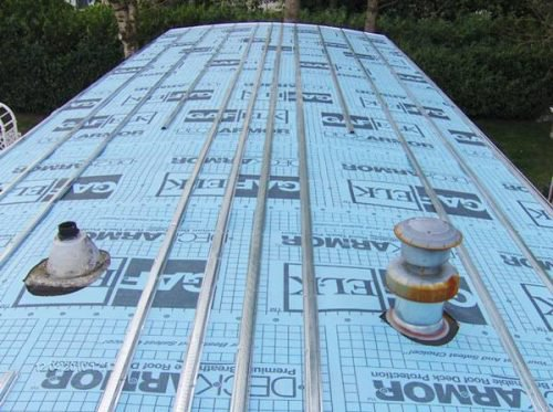 Mobile home roof over covered in deckarmour and then metal hat track approximately 16 inches apart 500x373 1