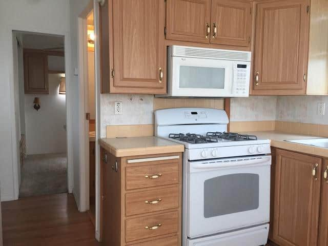 modern beach style manufactured home makeover - kitchen before