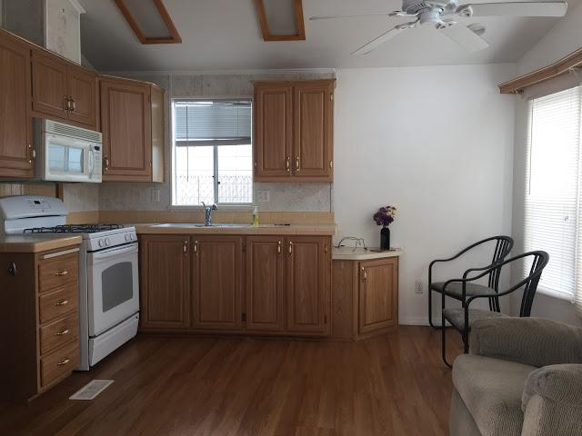 Modern beach style manufactured home makeover - kitchen before 3