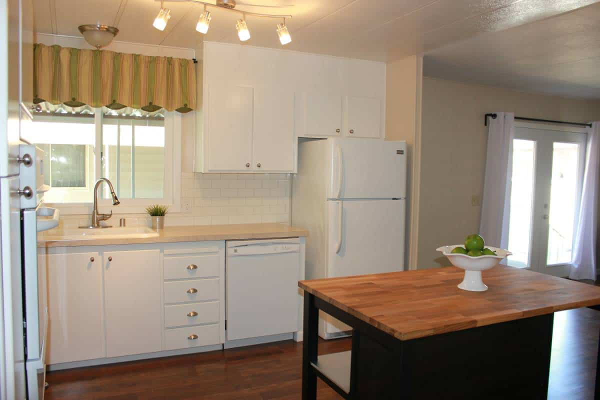 Painted kitche cabinets in remodeled manufactured home in san fran kitchen