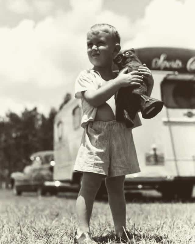 child in front of vintage mobile home 1940s