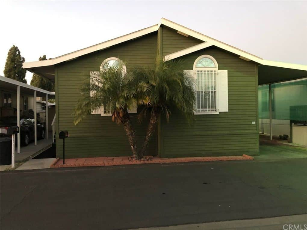 Paramount ca double wide with green siding