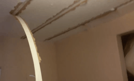 Ripping strips down from a mobile home ceiling