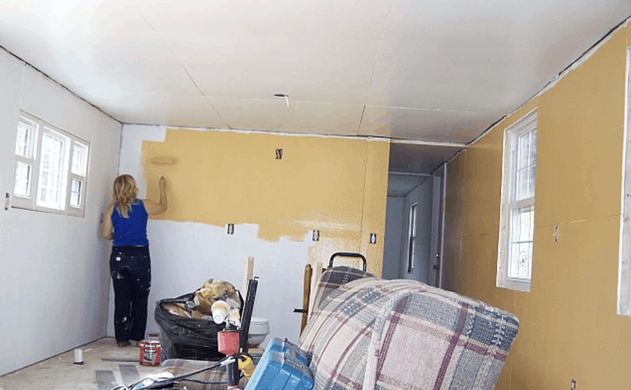 Total new drywall getting painted - mobile home transformation