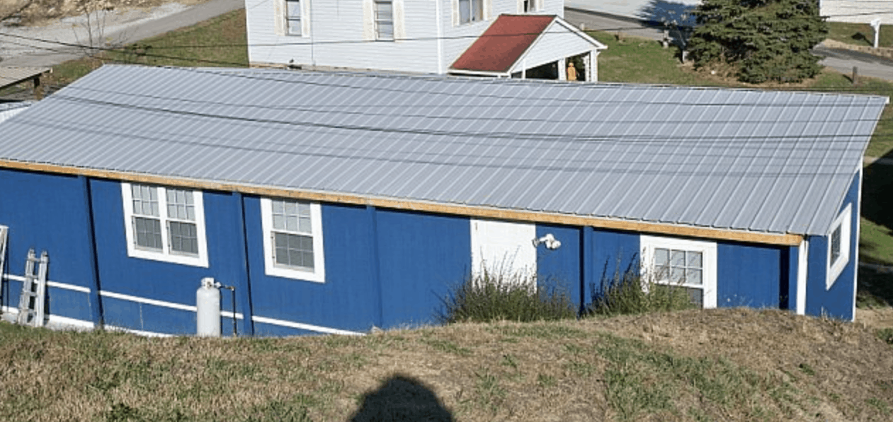 new siding and roof installed on old mobile home