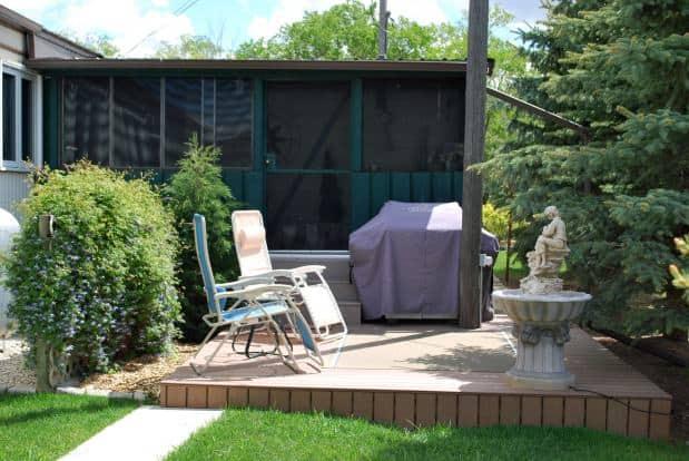 Screened deck in backyard - 1978 single wide in canada