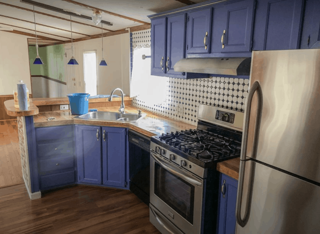 Single Wide Manufactured Home With Blue Kitchen Cabinets