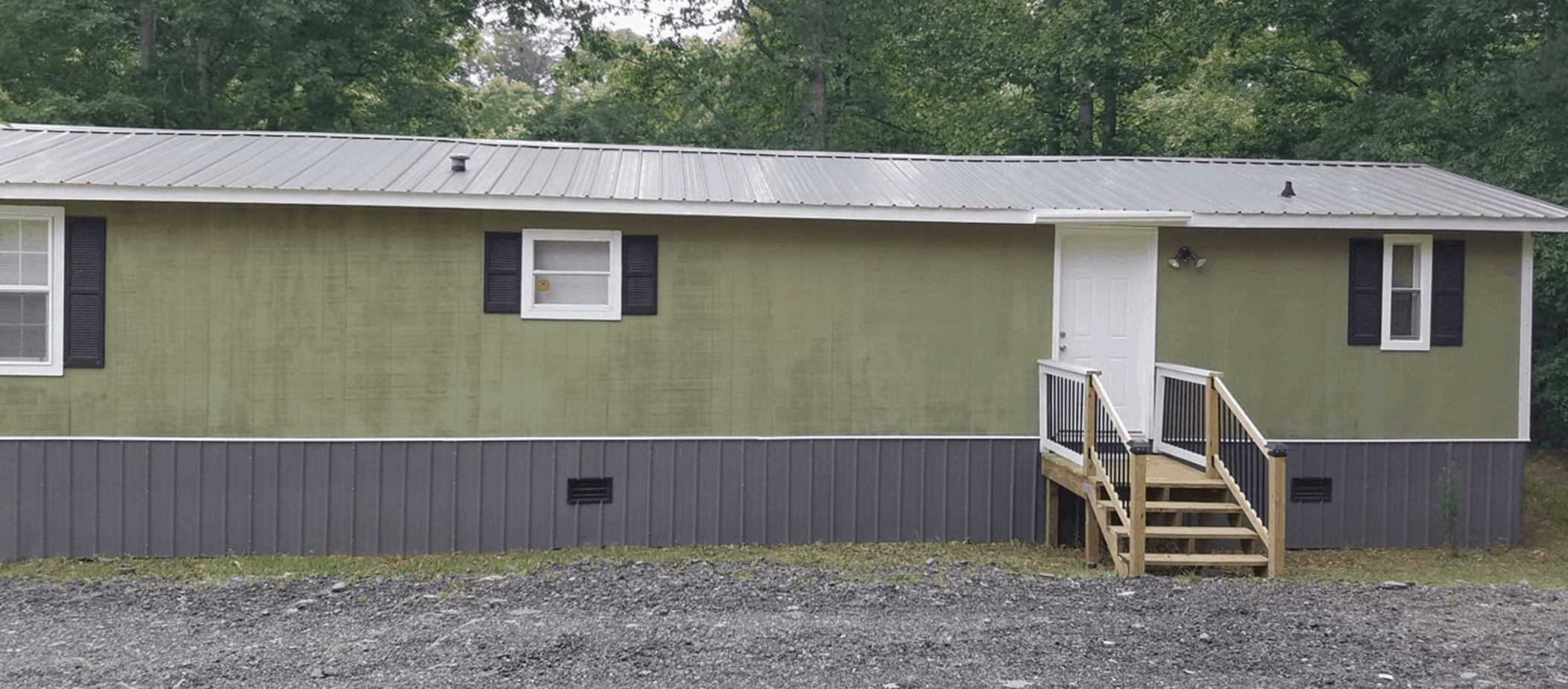 T11 Siding painted green on single wide mobile home