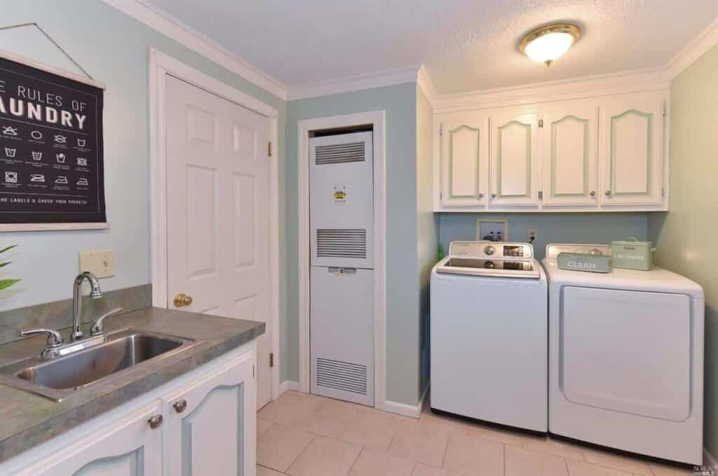 Utility Room Laundry Center And Furnace In Manufactured Home