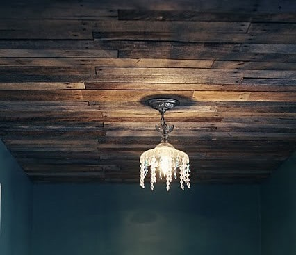 A-using-old-pallets-to-replace-the-ceiling-in-a-laundry-room