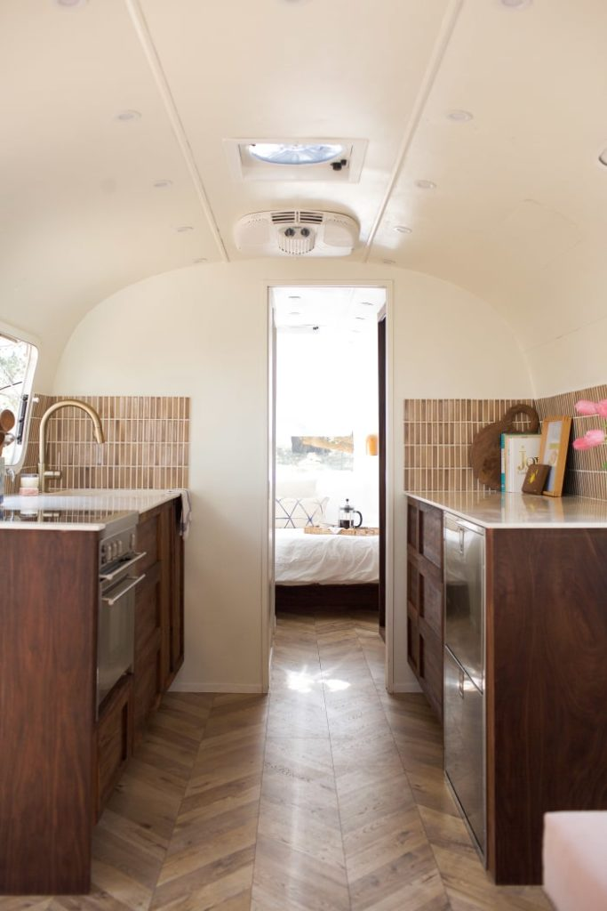 Airstream renovations pretty in pink kitchen