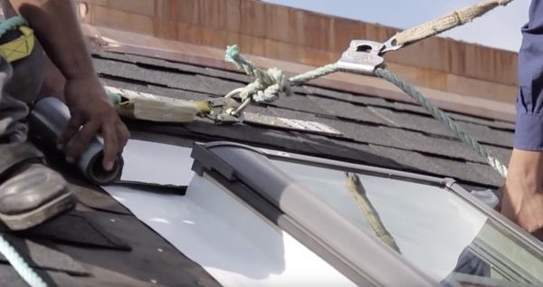 applying the underlayment over the flashing of a new skylight