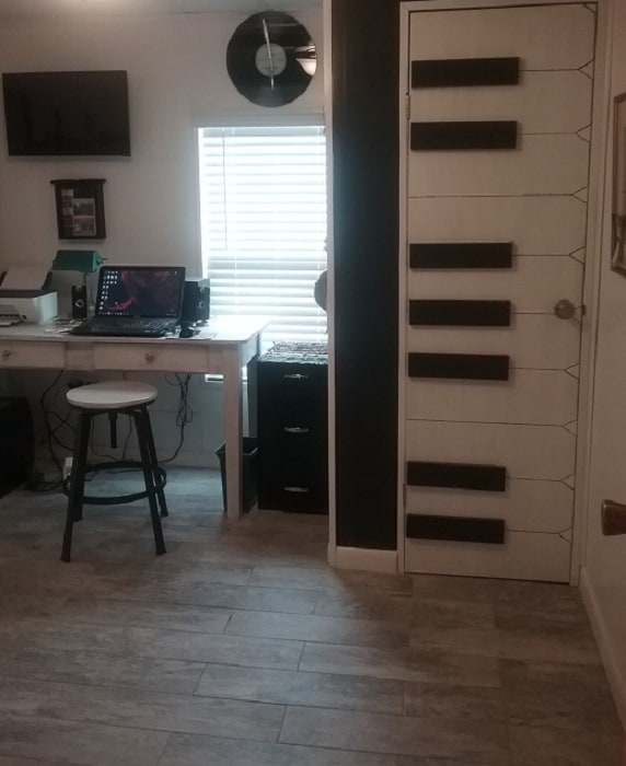 Beach theme mobile home  Office with piano keys on the wall