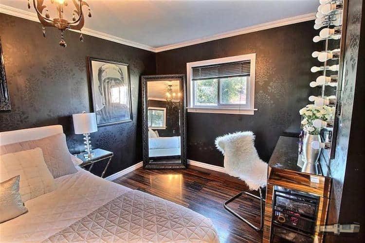 Black damask wallpaper creates gorgeous mobile home bedroom