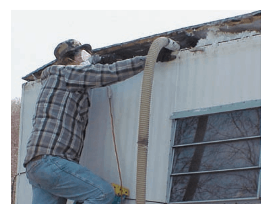 Blowing-new-insulation-into-mobile-home-attic-space-hud