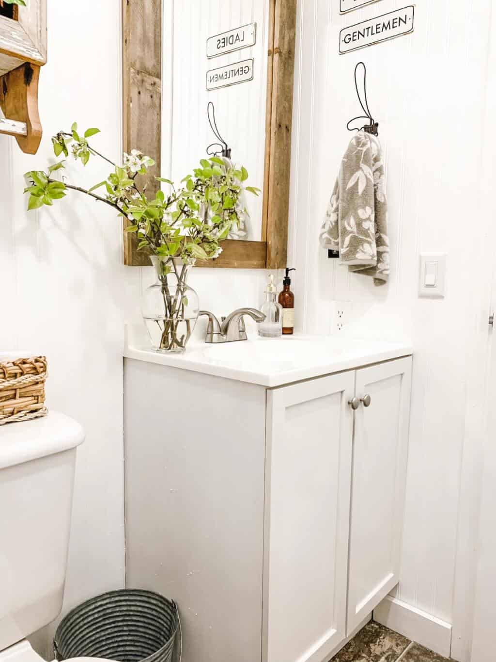 Cabinet And Vase - affordable farmhouse mobile home bathroom makeover