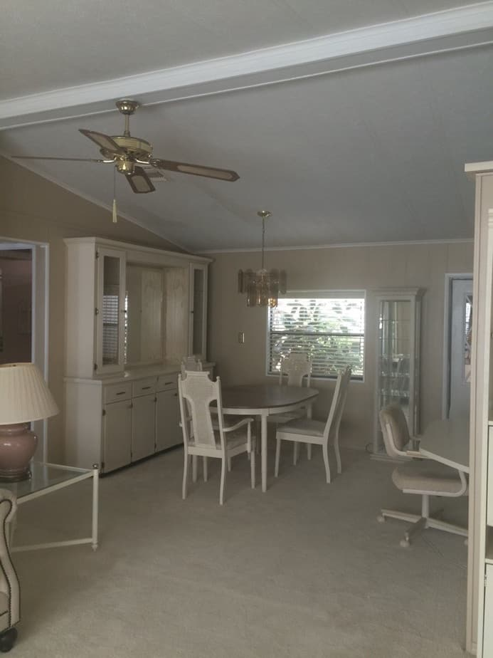 Coastal farmhouse mobile home remodel dining room before