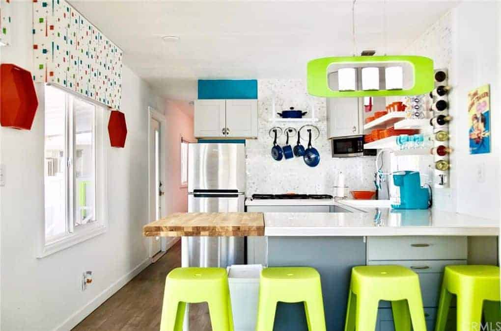 This Colorful Retro Mobile Home Is A Show Stopper on trailer homes, aretha's homes, retro park model homes, vintage homes, retro buses, retro motorcycles, retro furniture, 900 square foot homes, retro tile, one level homes, retro boats,