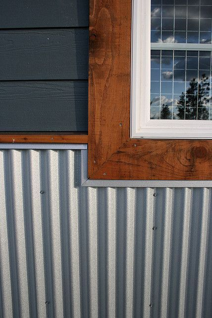 Corrugated metal panels as skirting on a mobile home