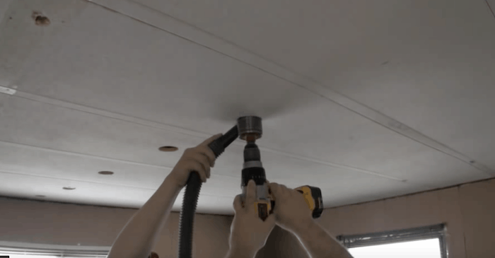 drill-and-plug-method-of-blowing-insulation-in-a-mobile-home-attic1