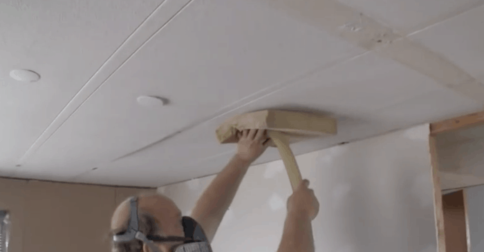 Drill-and-plug-method-of-blowing-insulation-in-a-mobile-home-attic3
