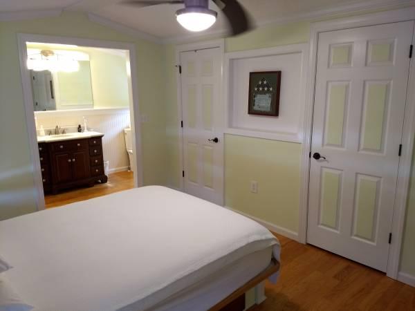 jacksonville-mobile home bedroom with neat closet doors
