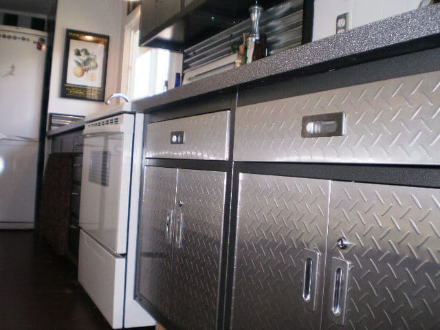 kitchen-with-sheet-metal-on-the-door