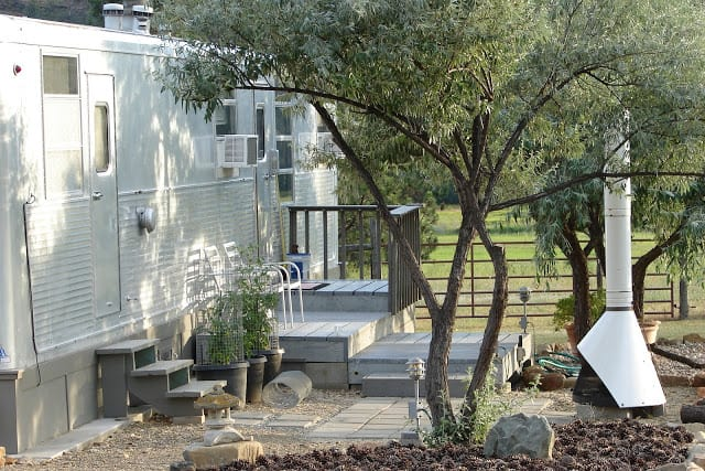 Landscaping around vintage mobile home