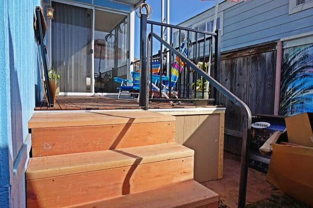 modern beach style manufactured home makeover -exterior after