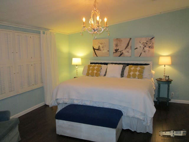 Master bedroom in mobile home with light blue walls