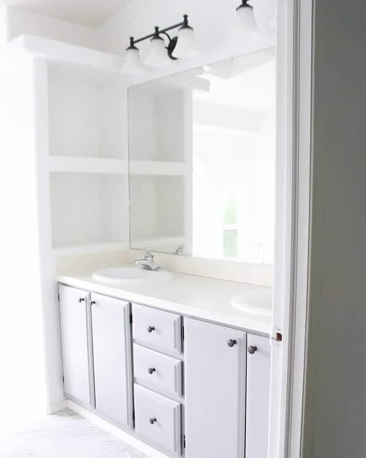 Mobile home flippers create beautiful farmhouse mobile home bathroom