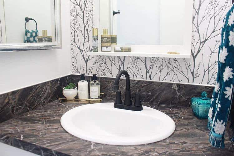 Mobile home flippers create beautiful farmhouse mobile home bathroom sink after mobile home flippers