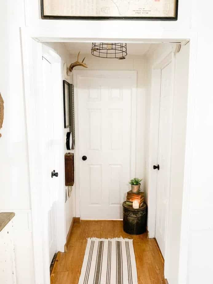 mobile home hallway with metal baskey light fixture - farmhouse style