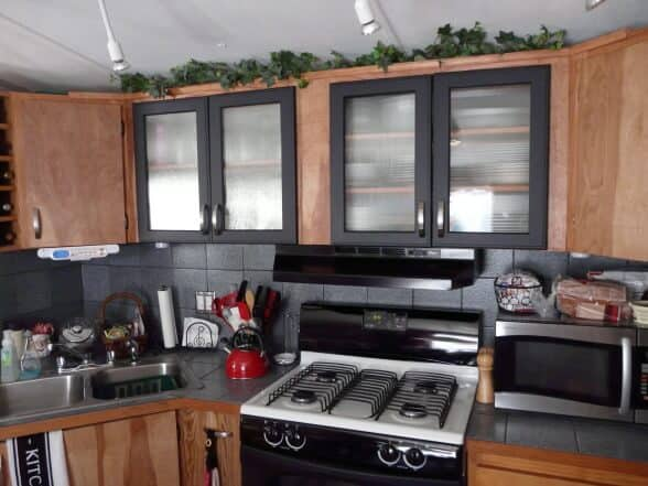 Mobile home kitchen with wood and gray cabinets